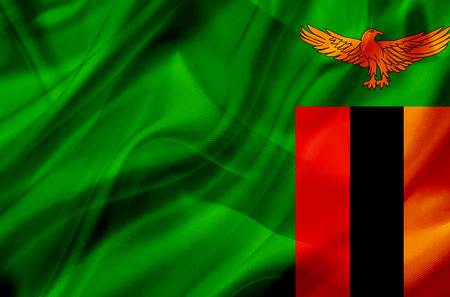 Zambia country flag symbol on silk or silky waving texture. Smooth fabric or material
