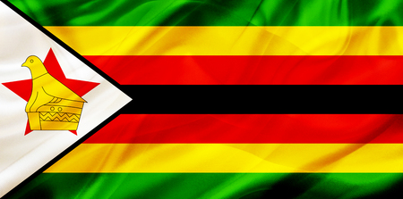 Zimbabwe country flag symbol on silk or silky waving texture. Smooth fabric or material Banque d'images - 123545864