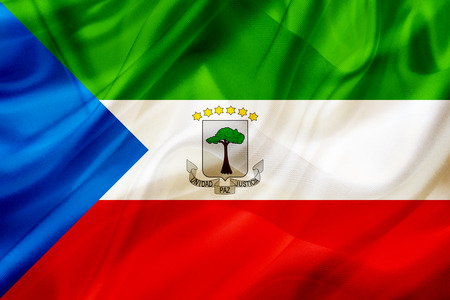 Equatorial Guinea country flag symbol on silk or silky waving texture. Smooth fabric or material Banque d'images - 123545865