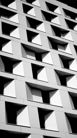 Architectural composition of black and white building windows. Black and white photography