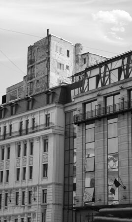 Black and white photography of a new and old building. Architecture concept Banco de Imagens