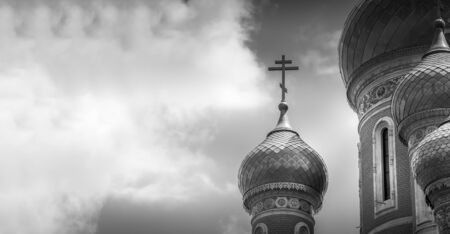 Classic Russian Christian Orthodox church golden plated close up in black and white photography