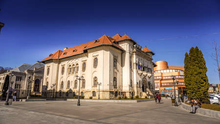 Campulung Muscel, Romania - June 20, 2020: Town hall or city hall in Campulung Muscel, Arges county, Romania. Beautiful architectural building located in the city center