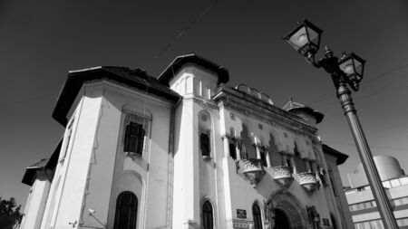 Town hall or city hall in Campulung Muscel, Arges county, Romania. Beautiful architectural building located in the city center. Black and white photography