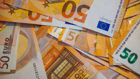 Big paper money pile of 50 euro bills or banknotes. Lots of money or currency. Money and finance. Concept of being or getting rich Stok Fotoğraf - 165973958