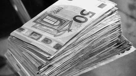 Big paper money pile of 50 euro bills or banknotes. Lots of money or currency. Money and finance. Concept of being or getting rich. Black and white photography