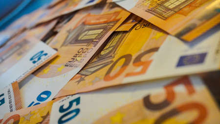 Big paper money pile of 50 euro bills or banknotes. Lots of money or currency. Money and finance. Concept of being or getting rich