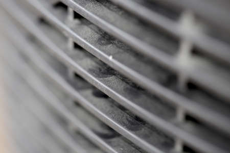 Dusty car radiator grill pattern background in black and white
