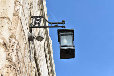 Lantern on the wall of medieval fortress