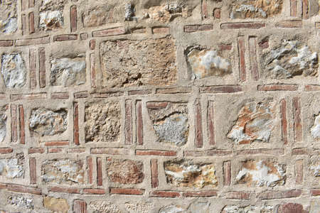 Medieval wall of stone and brick Stock Photo