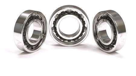 Horizontal arrangement of three ball bearings isolated on white background photo