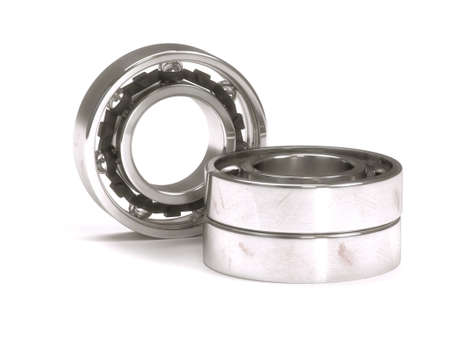 Ball bearing behind a stack of two ball bearings isolated on white background photo
