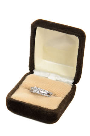 A diamond ring in a box, isolated against a white background Stock Photo