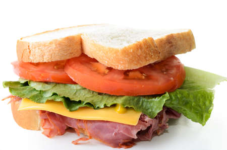 A corned beef sandwich with lettuce tomatoes and cheese  Stock Photo - 14457571