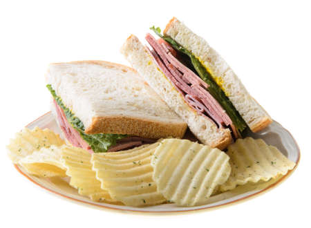 Bologna sandwich with potato chips, isolated on a white background. Stock Photo - 14842248