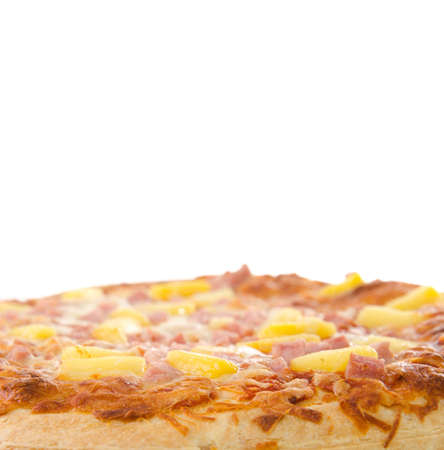 A cooked hawaiian pizza with white copyspace above. Stock Photo