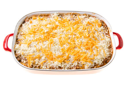 A cheesy casserole in a large dish, isolated against a white background. Stock Photo - 14842251