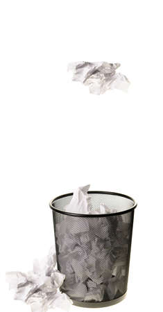 Paper being tossed into a garbage can, isolated on a white background  版權商用圖片