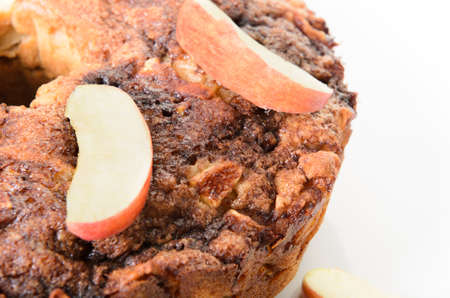 Closeup of an apple coffee cake, shot on a white platter  Stock Photo - 16402759
