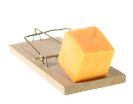 A set mouse trap with cheddar cheese, isolated on a white background Stock Photo - 16402741