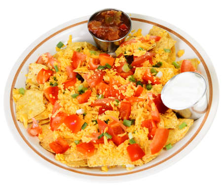 A plate of nachos and cheese, isolated on a white background  Stock Photo