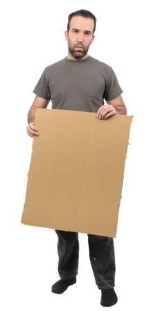A scruffy looking guy holding a blank piece of cardboard, isolated on a white background
