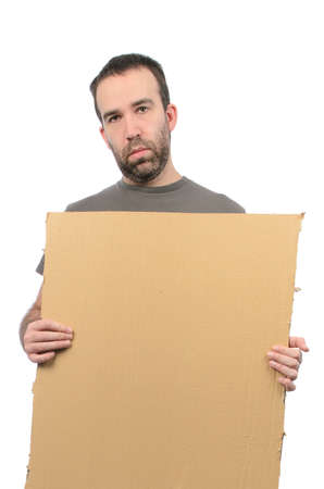 A scruffy looking guy holding a cardboard sign, isolated on a white background