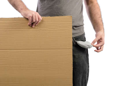 A moneyless man holding a cardboard sign with his pocket emptied out