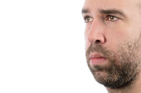 Closeup of a bearded man with white copy space on the left of the image