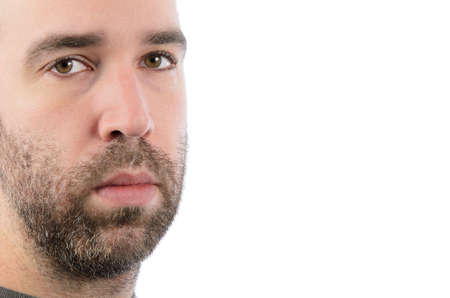 A bearded man looking at the camera, with copyspace on the right of the image  Stock Photo