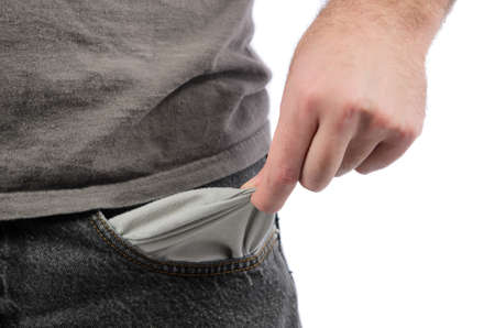 Closeup of a man holding out his empty pocket, isolated on a white background  Stock Photo - 17233673