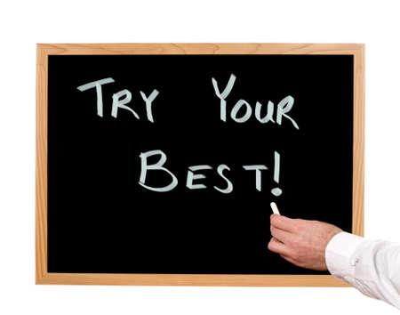 Try your best is written in chalk on a chalkboard  版權商用圖片