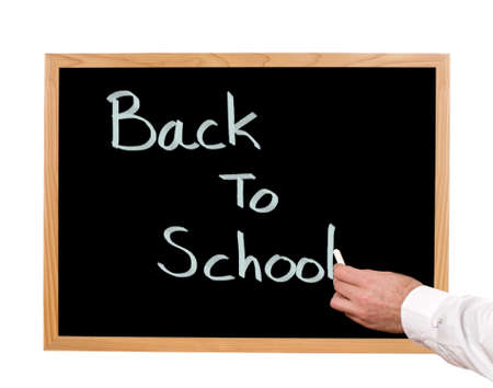 first day: Back to school written in chalk on a chalkboard  Stock Photo