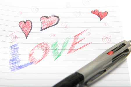 Pen drawing love doodle in a notebook Stock Photo