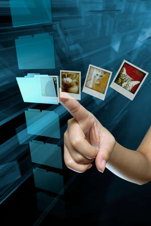 hard to find: a woman hand choice a folder on a screen Stock Photo