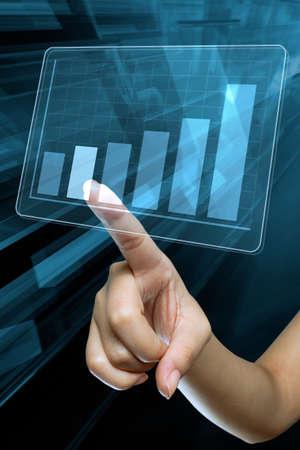 a woman hand make a graph on a digital screen