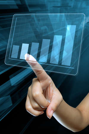 statistical: a woman hand make a graph on a digital screen