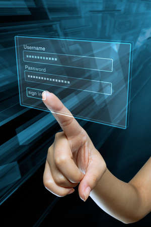 confidential: a woman hand sign in her login and password on a screen