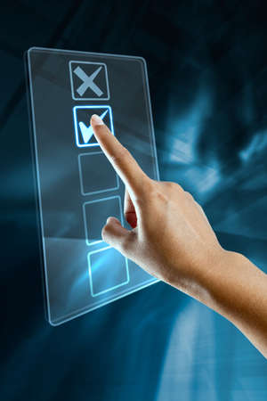 A woman hand selects an option on a screen Stock Photo
