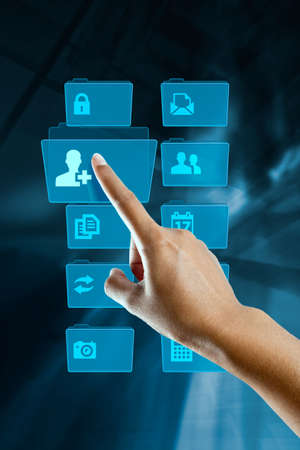 a woman hand choice a folder on a screen Stock Photo