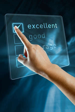 surveys: A woman hand selects an option on a screen Stock Photo
