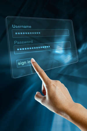 a woman hand sign in her login and password on a screen Stock Photo - 19673181