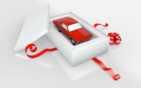 a red car in a white cardboard and red ribbon