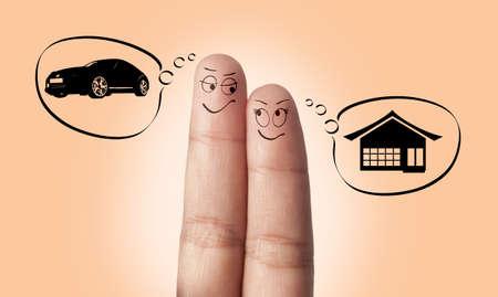 dream car: Un par de dedos en el amor soñando con una casa y un coche Foto de archivo