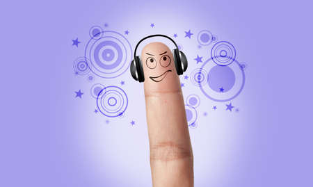 A finger listening music with a headphone