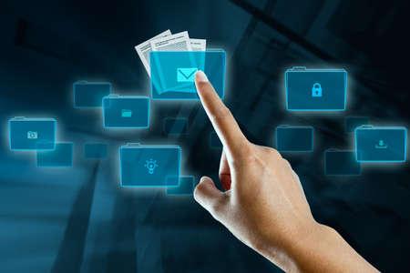 a woman finger selects a folder