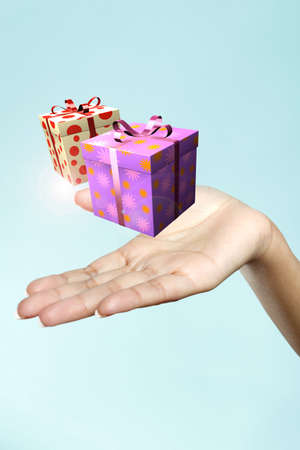 a gift  floats on a woman s hand
