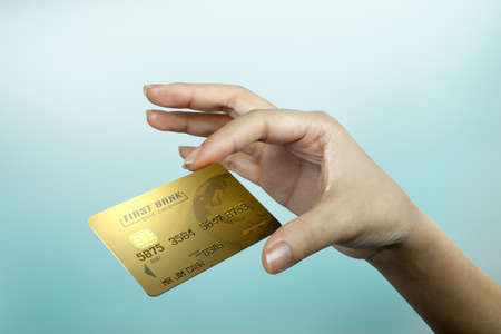 a credit card floats on a woman s hand
