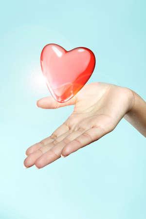 a heart floats on a woman s hand