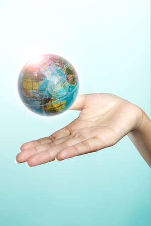a globe floats on a woman s hand  Stock Photo